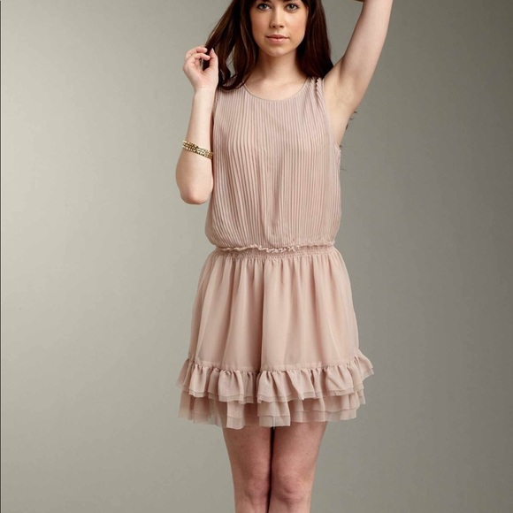 NWT mini pleated dress with ruffle hem. NWT. Romeo   Juliet Couture 126917d5d